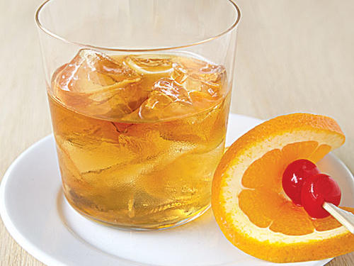 Each region of the country has its own favorite to reach for when 5 o'clock rolls around. If you want to sidestep the extra calories that come with mixing cocktails, use fresh fruit juices and calorie-free beverages rather than mixes, which are loaded with sugar.The Old Fashioned is a big hit in the Northeast.Place 1 brown sugar cube on a cocktail napkin. Sprinkle 2 to 3 drops orange bitters and 2 to 3 drops Angostura bitters over sugar cube. (Napkin will soak up excess bitters.) Transfer cube to a 10-ounce old-fashioned glass. Add 1 orange slice and a few drops bourbon to glass. Mash sugar cube and orange slice, using a muddler, until sugar is almost dissolved. (Avoid mashing the rind; doing so will release a bitter flavor.) Add 3 tablespoons bourbon, and fill glass with ice cubes. Stir until well chilled.SERVES 1 (serving size: 1 cocktail)CALORIES 110; FAT 0g (sat 0g); SODIUM 1mg