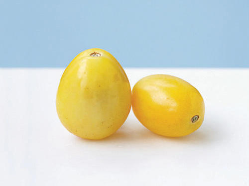 A mild-flavored yellow plum, this tomato earned its name because it is the size and shape of a chicken's egg. It's a creamy ivory color that turns yellow as it ripens. Enjoy the mild, sweet flavor of this variety either cooked or raw. It's a great garden selection, as it produces fruit up until frost.