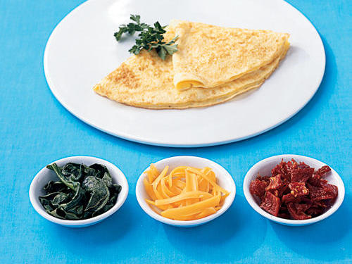 Two-egg omelet + Cooking spray = 147 caloriesAdd: 1 cup fresh spinach leaves, cookedGain: 7 calories, plenty of beta-carotene (1,688 milligrams) and 15 percent of your daily requirement of folate (58 micrograms), and a little potassium, calcium, and ironAdd: 2 tablespoons shredded reduced-fat cheddar cheeseGain: 45 calories, 4 grams of protein, and 10 percent (100 milligrams) of your daily calcium requirementAdd: 2 tablespoons chopped sun-dried tomatoes in oilGain: 30 calories, the cancer-fighting antioxidant lycopene, nearly a gram of fiber, 14 milligrams of vitamin C, and a bit of potassium and magnesium