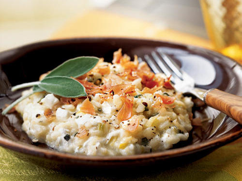 Diced mozzarella melts but doesn't completely disperse in this rice-based risotto. Little pockets of warm cheese will surprise and please you. Substitute basil for sage, if desired.