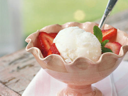 Though it commonly adds zing to biscuits, pancakes, and waffles, buttermilk rarely gets to express its natural tanginess by itself. However, this frozen treat lets it play center stage, adding slightly sweetened strawberries for color and variety.