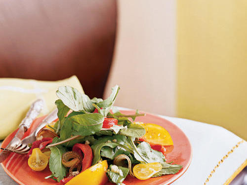 "This summery recipe inspired reptileenthusiast to try something new. ""The flavors of this salad match so well―smoky grilled red onions and red peppers, peppery arugula, and sweet dressing. This was the first time that I had tried yellow tomatoes and they definitely added to the overall flavor mix."""