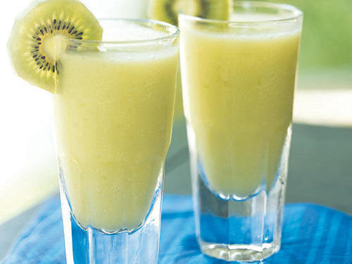 Tropical coconut and pineapple combine with melon liqueur and the subtle flavor of kiwi in this blended iced cocktail whose green color looks absolutely gorgeous on any party table. If you can find them, try using golden kiwifruit instead for a sweeter taste and pretty golden color.
