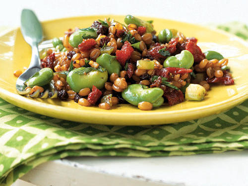 Fresh favas are an early-summer treat that disappear pretty quickly. Take advantage with this hearty salad that packs in all sorts of nutritious elements―from the whole-grain power of spelt to vitamin-rich dried currants and tomatoes.