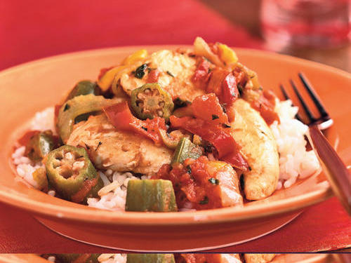 Healthful convenience ingredients such as frozen vegetables and canned tomatoes make this a great weeknight staple to add to your repertoire. For a filling meal, serve over rice.