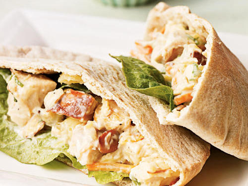 If you don't have pitas on hand, substitute whole-grain bread for this interesting chicken salad. Pineapple adds a hint of sweetness, while matchstick carrots and slivered almonds add texture and crunch. The recipe calls for canned pineapple, but works equally well with fresh if you've got the time.