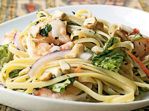 Sriracha, a Thai hot sauce, adds a spicy kick to this Asian noodle salad. Use less or omit it to tone down the dish. If you can't find fish sauce, substitute low-sodium soy sauce.