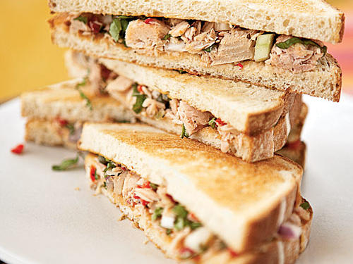 With fresh basil, pungent onion, crunchy fennel, briny capers, and bright lemon juice, this tuna salad needs no mayonnaise to be absolutely delicious. Toasted bread is nice, but if you're in a hurry, skip that step; the tuna will be just as good.