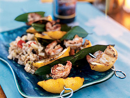 This superfast recipe shows just how easily shrimp can soak up flavors. A 10-minute bath in lemon juice, pepper, and garlic adds acid and spice, then grilling with bay leaves and lemon wedges infuses the shrimp with woodsy flavors and even more citrus. Serve on the skewers for a colorful, fun presentation.