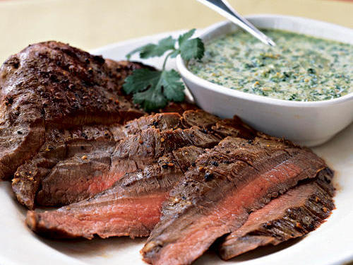 "Doy92064 really loves the sauce for this simple grilled steak, saying, ""Wow—the best pesto without all the oil that packs a nice spicy taste. The pesto really complimented the grilled flatiron steak. Next time will double the recipe in hopes there will be"