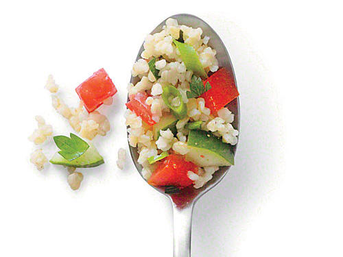 Bulgur provides an excellent base for the vibrant colors and crisp flavors of the tomatoes and cucumbers.