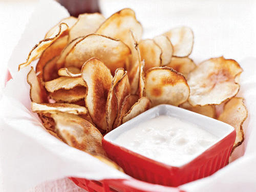 Don't deny yourself; instead, make them yourself. We've made over a classic here. Use a mandoline to cut the potato for best results; hand-cutting is less likely to produce sufficiently thin and uniform slices. If you have any leftover chips, store them in an airtight container for up to a week.View Recipe: Potato Chips with Blue Cheese DipRead more:  Make Your Own Veggie Chips
