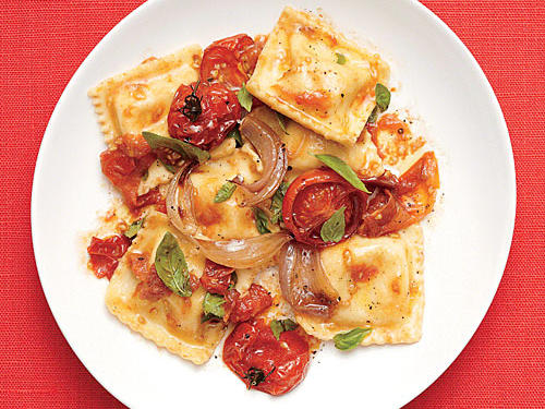 Take plain cheese ravioli from boring to beautiful with a mix of cherry tomatoes, shallots, and basil.