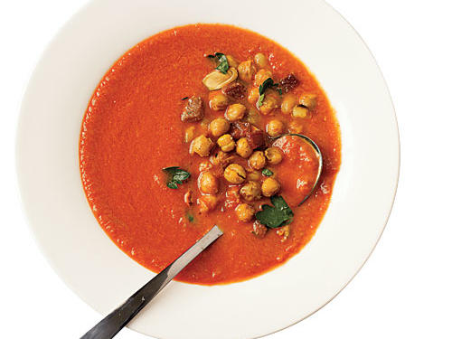 Roasting the chickpeas with garlic, ham, and cumin gives this soup incredible flavor, and topping it with parsley and almonds ensures delicious texture in every bite.