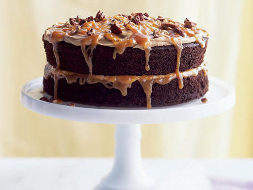 This decadent cake, which plays off the popular Turtle candies, boasts chocolate layers and a nutty caramel glaze.