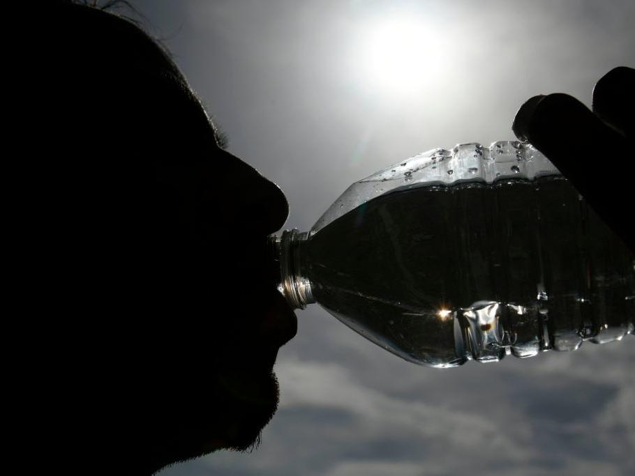 A person drinking a bottle of water