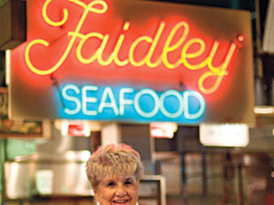 At Faidley's Seafood in Lexington Market, the lump crab cakes are the size of baseballs.