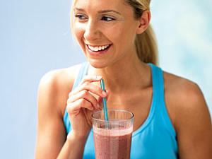 Woman drinking smoothie