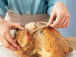 Once you've presented the finished turkey to guests, remove and discard the skin to dramatically reduce fat intake.