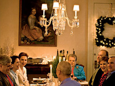 Ella Brennan presides over a table of family and friends gathered to enjpy a festive meal inspired by Reveillon feasts from days gone by.