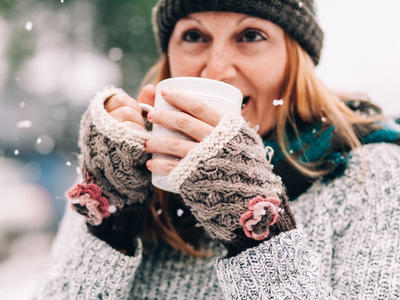 Woman Drinking Cocoa in Snow