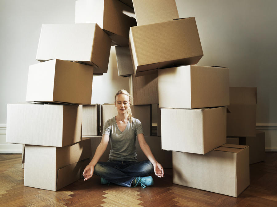 Girl Sitting in Front of Moving Boxes
