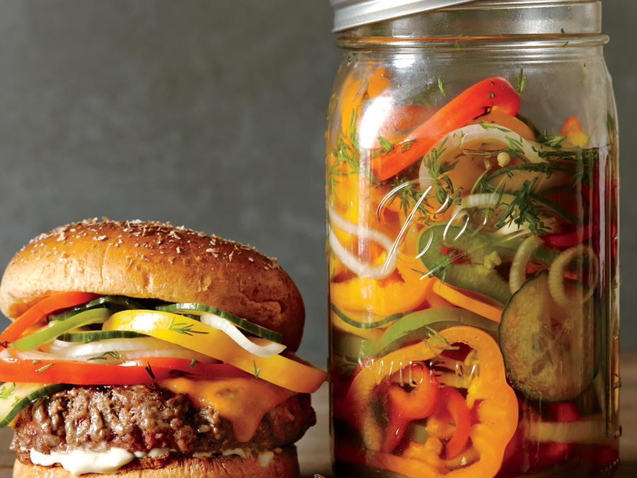 Cheesesteak Burgers with Pickled Peppers, Onions, and Cucumber