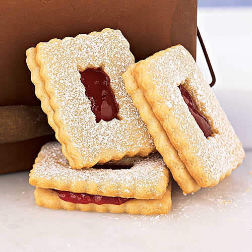 """Use a heart-shaped cookie cutter to say """"I love you"""" with our Raspberry Linzer Windowpane Cookies (pictured)."""