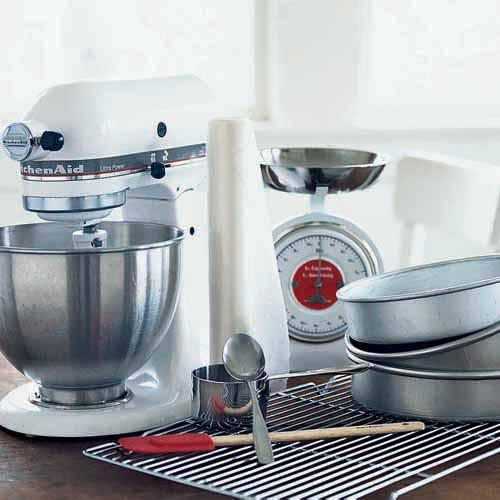 An electric mixer incorporates the most air into cake batter. You'll also need a spoon, dry measuring cups (or kitchen scale), quality cake pans, a rubber spatula, wax paper, and a cooling rack.