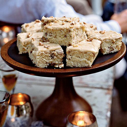 A simple sheet cake is dressed up with pleasantly bitter walnuts and a sweet, creamy frosting to create this treat both kids and adults will love.