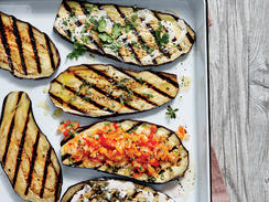 Grilling eggplant allows its flavor to really shine, but our four simple toppings take this speedy side to the next level. Top it with Miso Aioli, Sherry Vinaigrette, Creole Salsa, or Creamy Lemon-Garlic Dressing. Be sure to choose smaller eggplants; they'll be easier to slice and easier to handle on the grill.