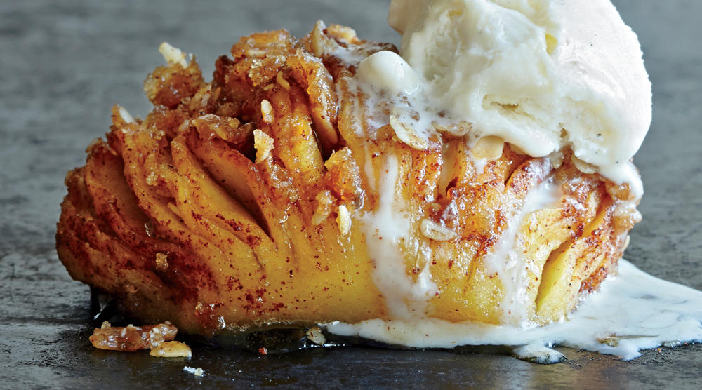 Simple and easy to make ahead—this twist on the apple crumble is unbelievably good. With cinnamon-sugar butter between the layers, a crispy streusel sprinkle, and a dollop of ice cream on top, there's no doubt this will be a hit with your friends and family. For a gluten-free version, omit the flour and substitute with certified gluten-free oats.