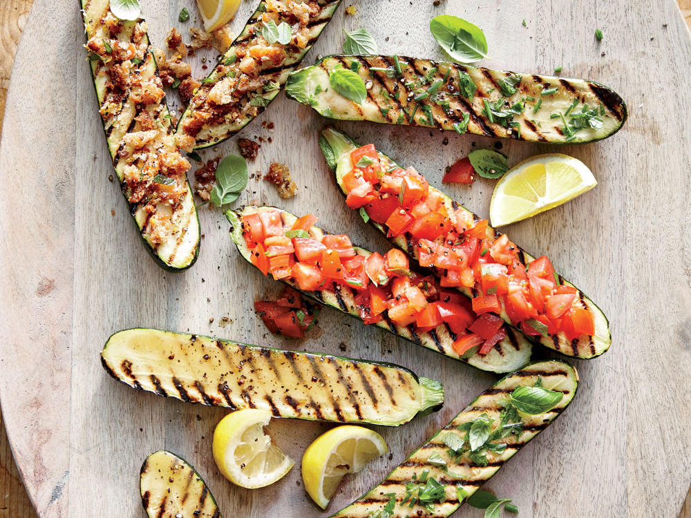 These zucchini sides couldn't be easier. Simply mix your favorite topping, half the zucchini, and grill. Our Grilled Zucchini with Lemon-Garlic Breadcrumbs uses fresh breadcrumbs from a whole-wheat baguette, while the Grilled Zucchini with Herb Butter boasts fresh chives, basil, and lemon juice. For spicy flavor try our Grilled Zucchini with Chopped Tomato-Basil Salsa, or stay cool with Sweet and Sour Grilled Zucchini.