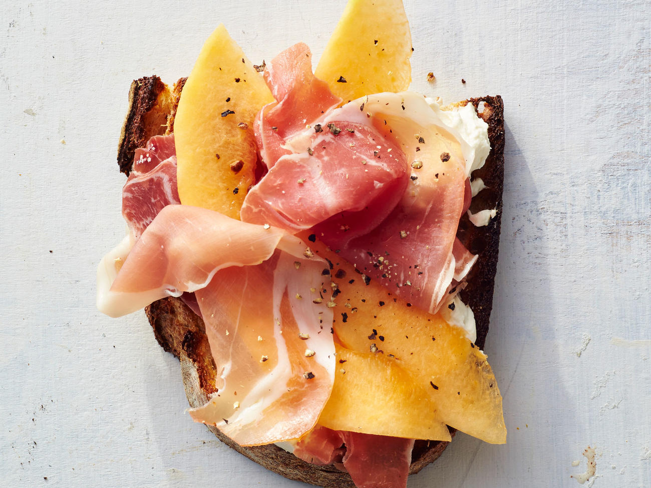 The classic combo of prosciutto and melon, just in toast form.