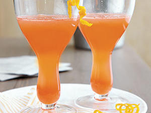 Campari, an Italian aperitif, gives this cocktail a bitter edge and beautiful rosy color.