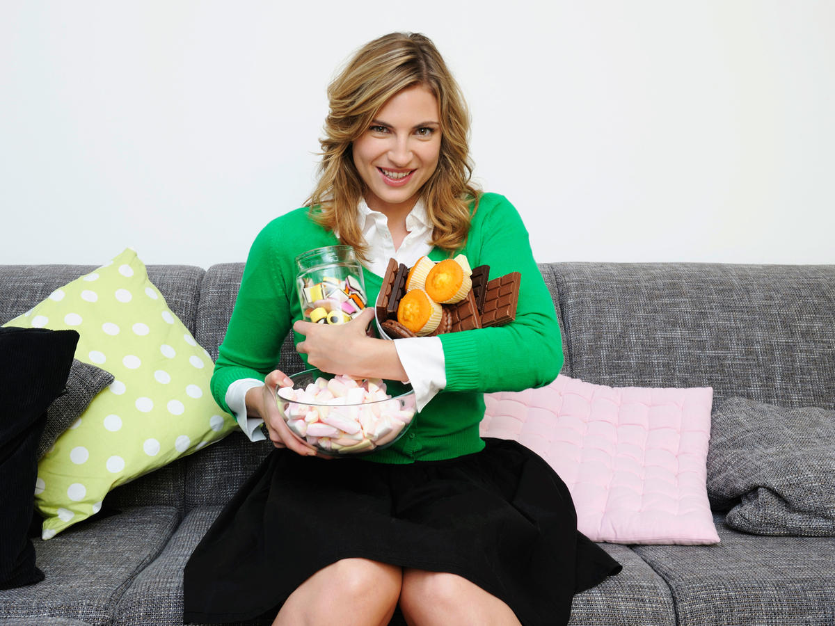1609w-getty-woman-couch-junk-food.jpg