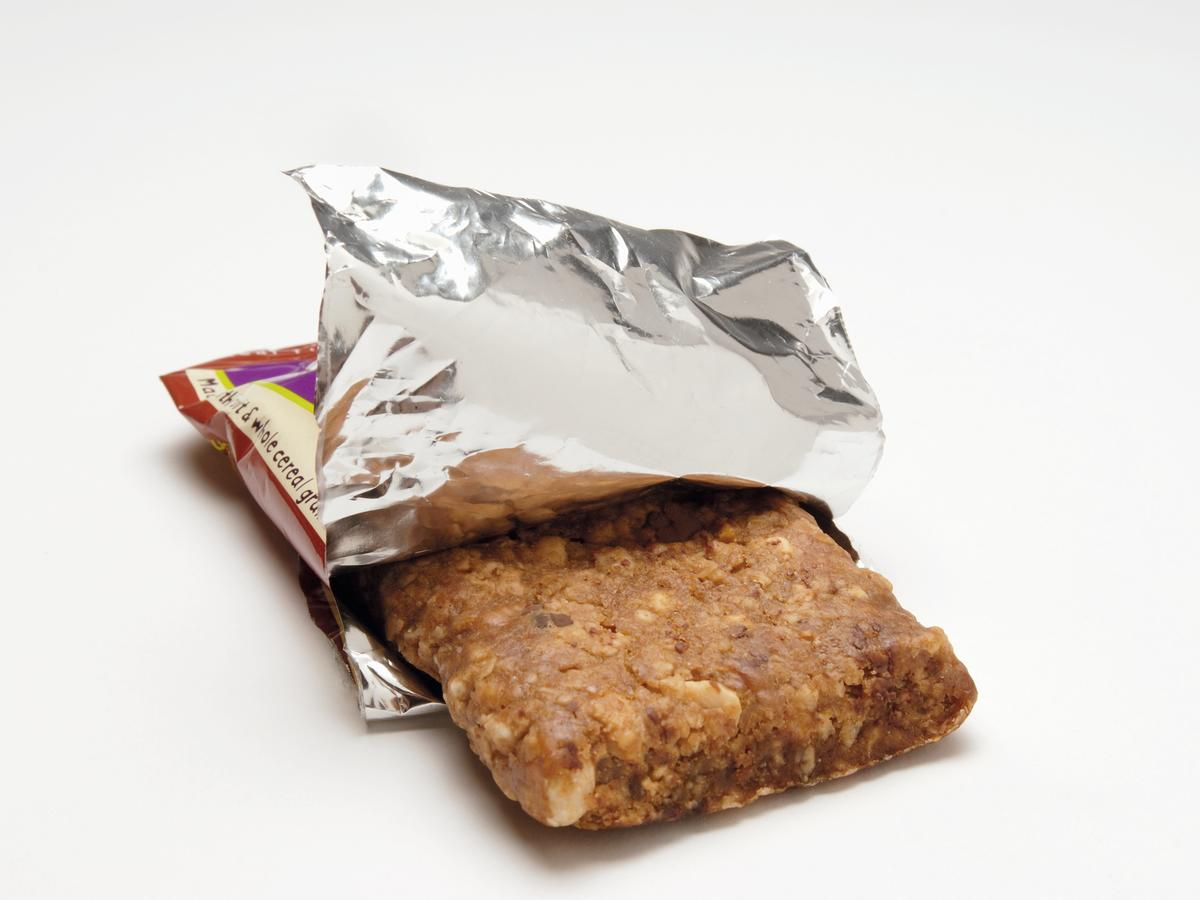 Muesli bar in opened packaging