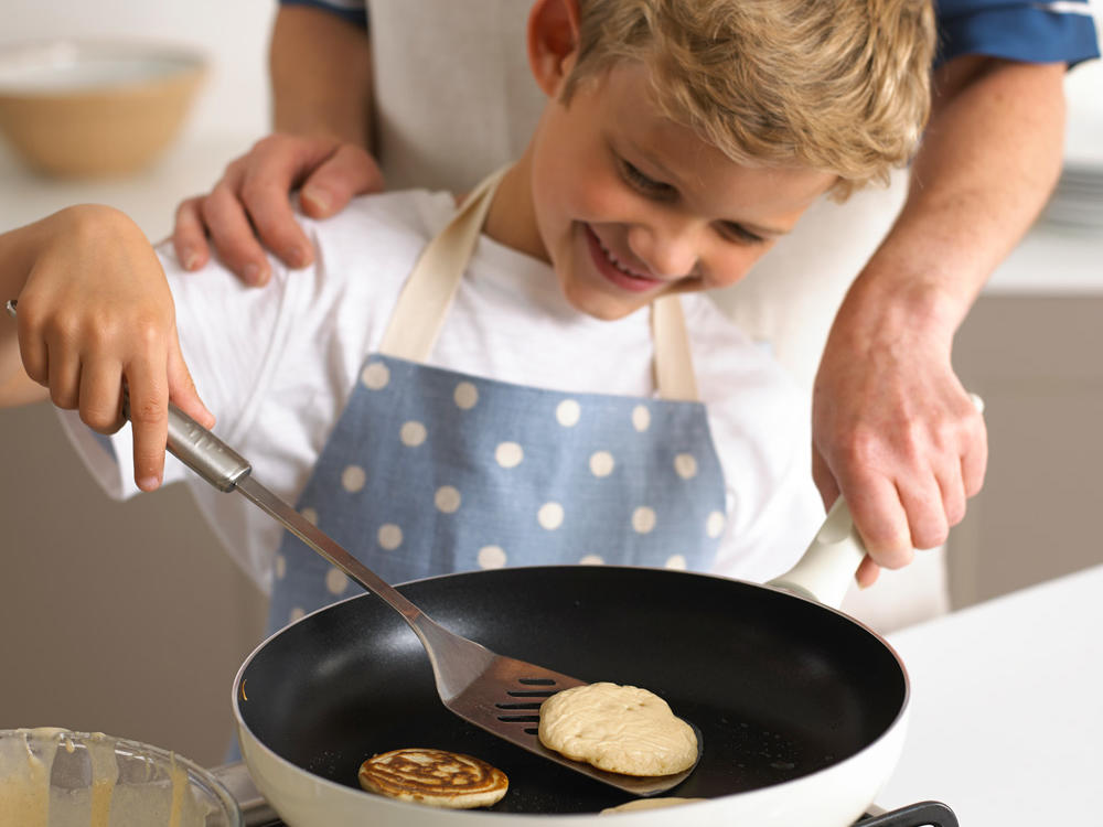 1512w-kid-cooking-pancakes-getty.jpg