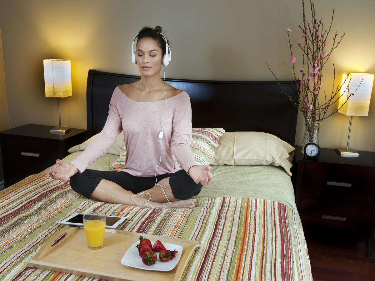 Woman Meditating and Using Headphones