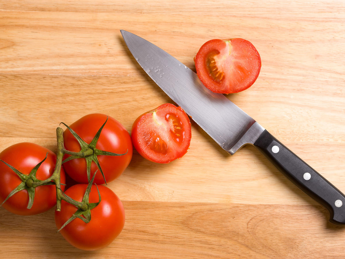Knife Slicing Tomatoes