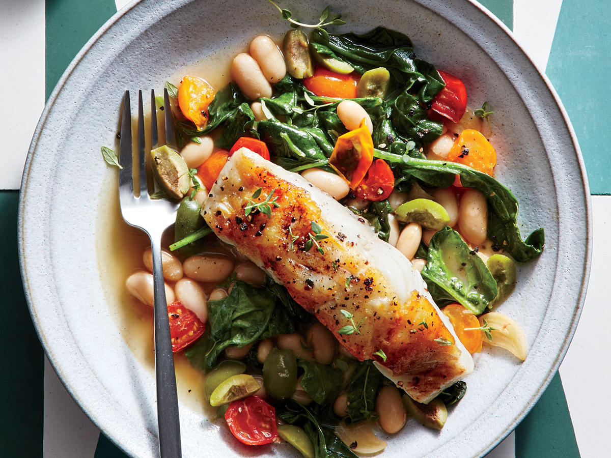 Seared sea bass with lemon olive white beans recipe for Bass fish cooking