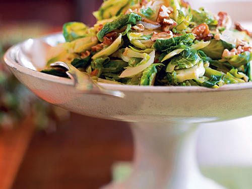Slicing the Brussels sprouts horizontally makes for quick cooking, and the addition of toasted pecans add an unexpected crunch and buttery richness to this stunning side.